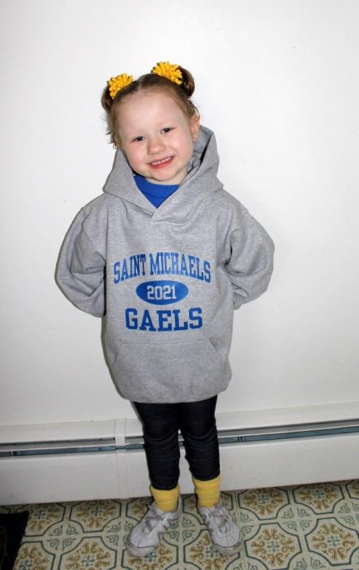 Kelsey wearing  Prep Sportswear's Holloway Kid's 50/50 Hooded Sweatshirt Size Medium.