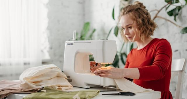 woman-sewing-while-sitting-on-chair-3738088