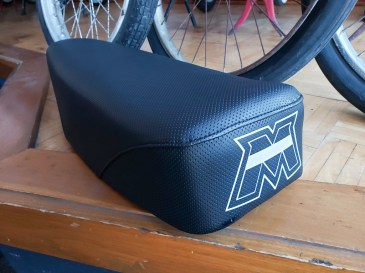 """Reproduction Motobecane """"M"""" applied to new seat by heat transfer."""