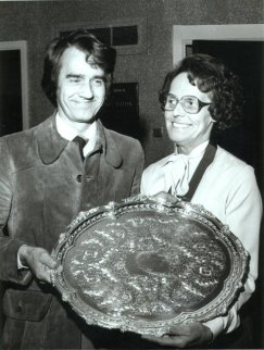 Jennie Chadwick receives the plate from a Salford College lecturer in the foyer of Tyldesley Pool