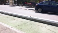 These Temporary Bike Lane Barriers Let Cities Experiment With Better Biking Infrastructure