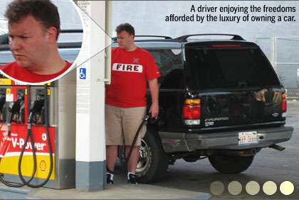 and unhappy car commuter looks to be angry because of paying so much for gas