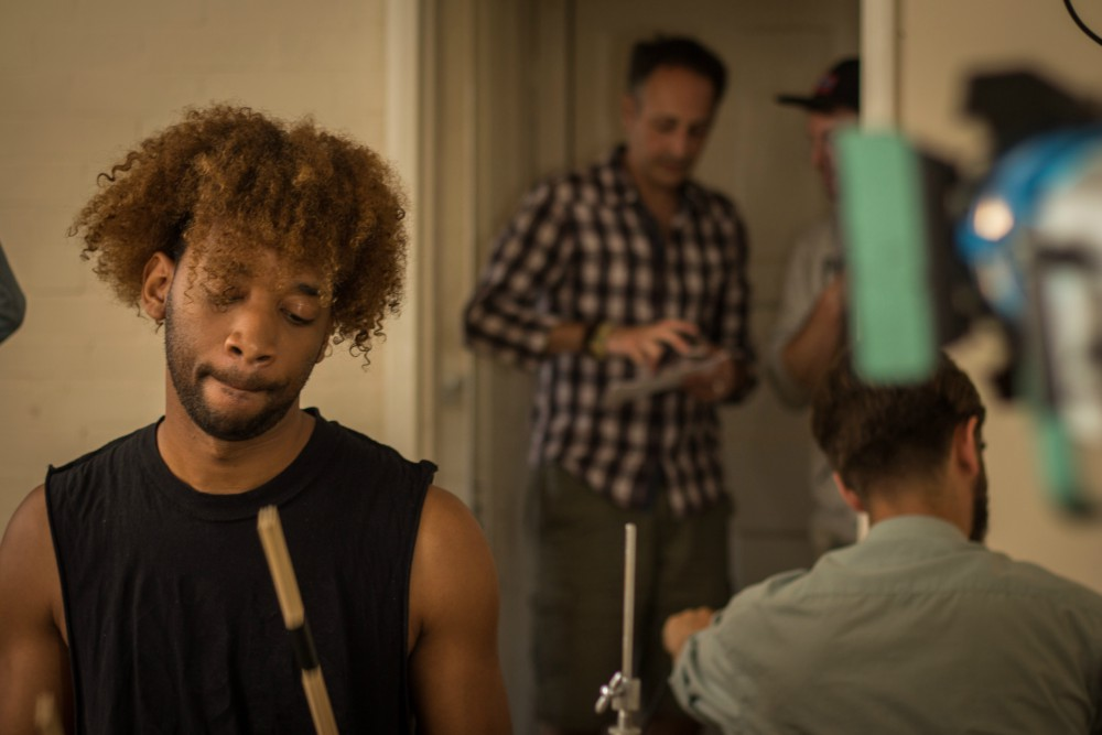 Actor Oraine Johnson on set of Repercussions with writer/director Charlie Coldfield in the background. Courtesy of Ben Tallamy