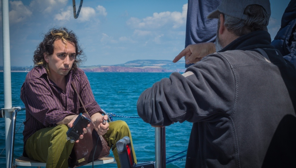 Ben Tallamy on the boat filming All That Remains
