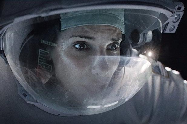 wide eyed sandra bullock in a space helmet in gravity