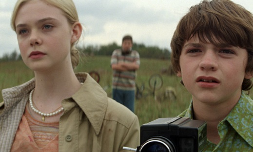 two young people look to the distance in a filed in super 8