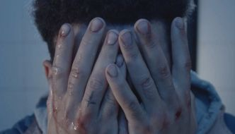still from Bulldog - a man has his head in his hands