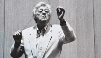 George Lloyd conducting holding a batton