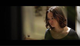 Terminus still. A woman seen through a window