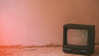 a tv on a desolate landscape
