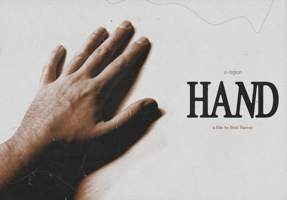 a left hand, next to the title 'hand', the poster for Brett Harvey's short film