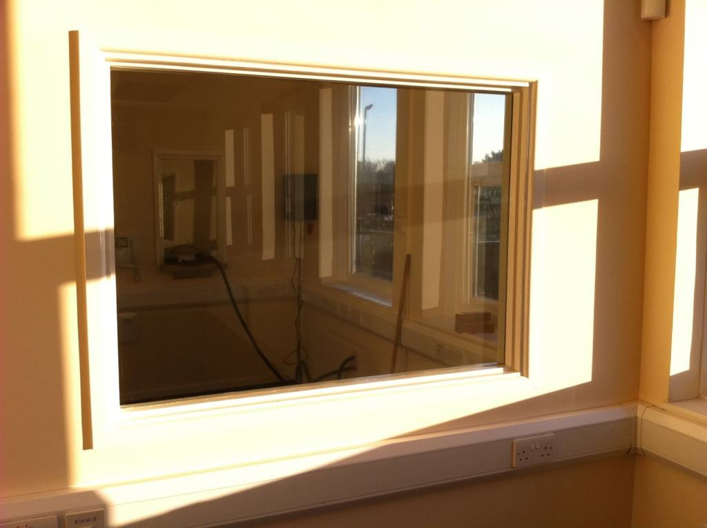 Hanita Titan Dual 05 internal one-way privacy film for an office in Exeter - before