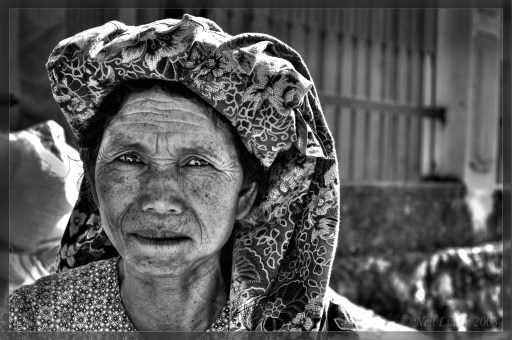 This lady was selling chilies at a busy morning market in Rantepo, Toraja. I found it difficult to communicate with a lot of people around this area, as Indonesian isn't always spoken. Luckily, her friend could translate Bahasa Indonesia to Torajan and I got the shot. WWW.NEILSRTW.BLOGSPOT.COM