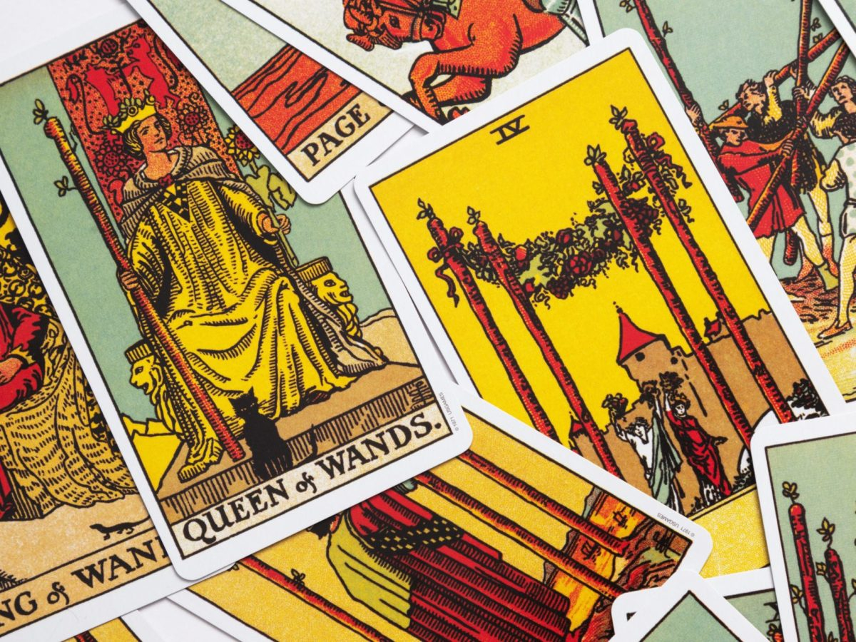 Close up of the Rider Waite Smith tarot deck, the cards are spread out across a surface
