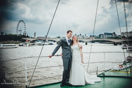 bride and groom together on the thames
