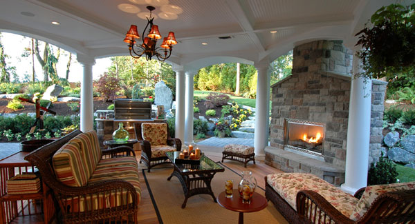 covered outdoor patio living space Your Deck Is Glowing (With Fire Features) - DFD House
