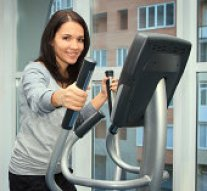 woman using Elliptical trainer