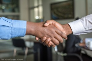 hand shake with cytonn-photography credit represents selling a business