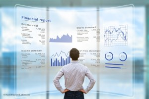 man looking at financial statement report NicoElNino AdobeStock