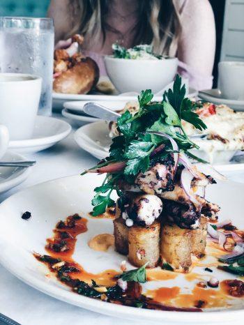Patatas bravas and octopus at Perla's Austin
