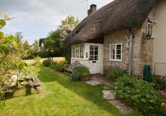 retreat to this thatched cottage for two