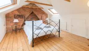 traditional-purbeck-stone-cottage-master-bedroom