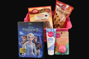 Picked out by the ladies of Willow Tree Lodge, this package includes some of their favorite things like brownies, cookies, lotion, and a Frozen 2 DVD!