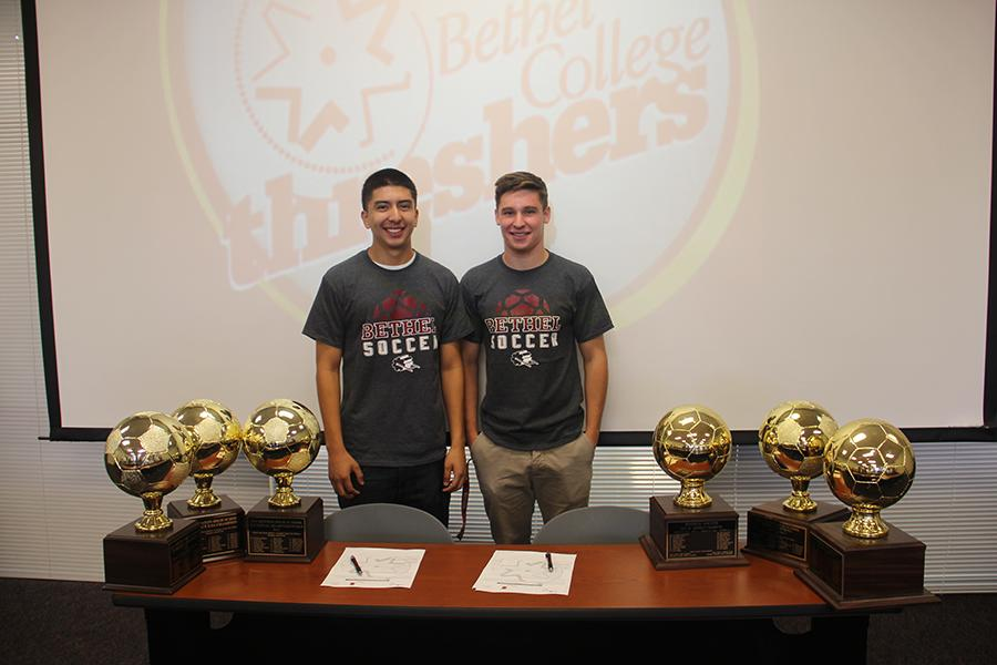 Soccer+Captains+Chris+Torres+and+Chandler+Page+pose+for+the+camera+after+signing+letters+of+intent+to+Bethel+College+in+Kansas.