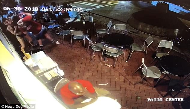 In front of tables of customers, Emelia throws the man to the ground before giving him a very public dressing down