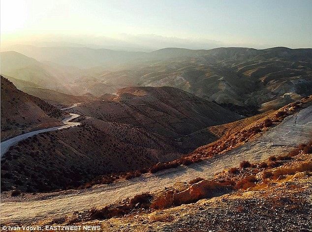 The child's father pleaded with Ivan Vdovin, 27, to help his daughter Zakura, seven, escape the long-established path for girls in his traditional and partly nomadic society in Wadi Qelt valley (pictured) on the Israel-Palestine border