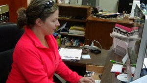 Heather Mullinix works at her desk at The Crossville Chronicle. (Photo by D. Krahulek)