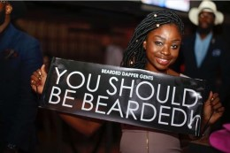 A women holding You Should be Bearded Sign Event