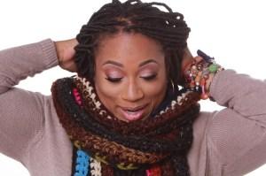 Nikki Harris of HGE Designs, Scarve wrap around her neck.
