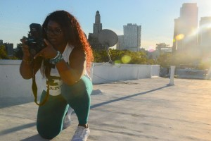 Moko Mettle-Nuno of M2N Photography taking professional photo on the roof