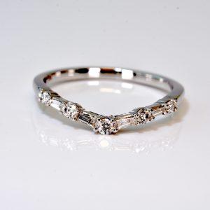 14 kt. White Gold Contoured diamond wedding band.