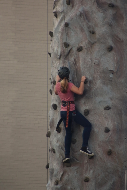 woman climb wall