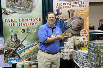 Mark Kaufmann proudly displays the Diana Jones Award in the Days of Wonder booth at Gen Con Indy 2005. (Photo by Rick Thornquist)