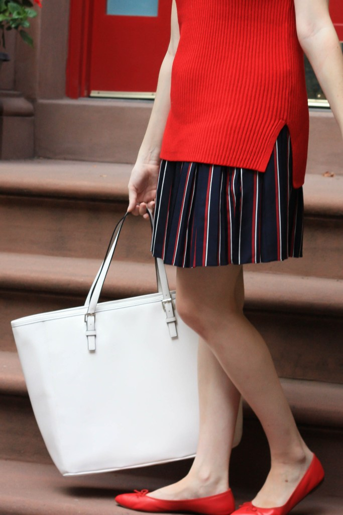 Diana Pearl wears red sleeveless sweater from J.Crew and striped skirt from Banana Republic on Pearl Girl