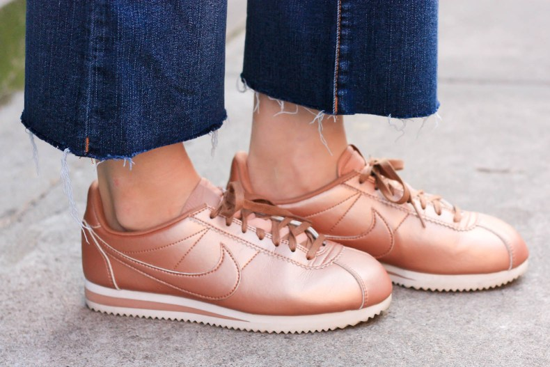 Fashion blogger Diana Pearl of Pearl Girl wears Nike Classic Cortez Sneakers, Crop Flare Jeans