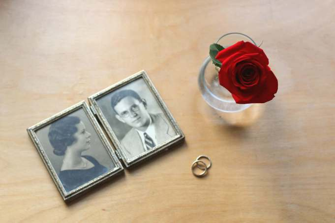 framed photos of couple and wedding rings and red rose