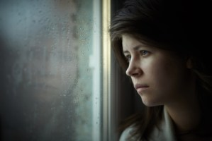 woman-looking-through-window