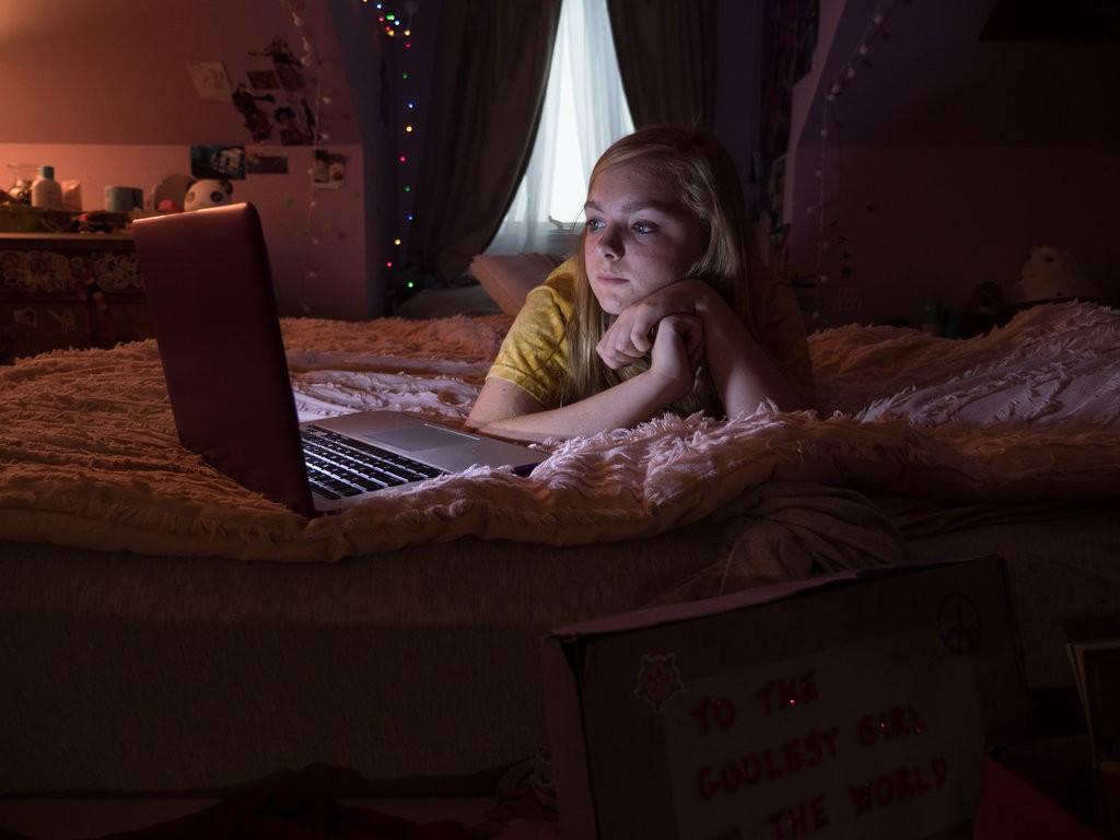 teenage girl with computer