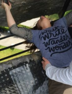 Ireland 101: Image of me being lowered down to kiss the Blarney Stone.