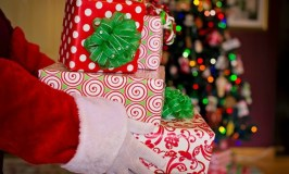 A trio of Santa Claus Tales: Image of Santa's hands with presents.