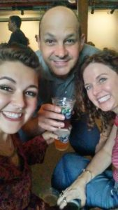 Adult kids: image of mother, father, and daughter having a beer together.