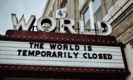 Everything Belongs: Image of a theater marquis saying: The World Is Temporarily Closed