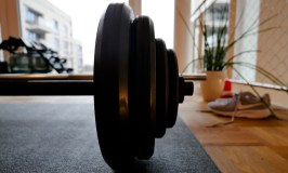 Resistance Training: Image of barbell and sneakers in living room