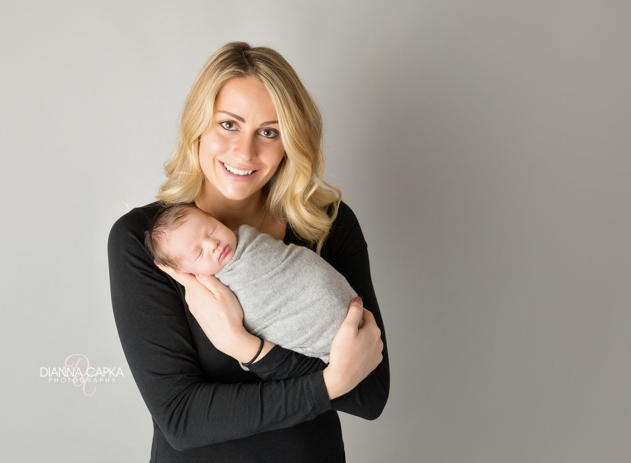 Mom and newborn boy black and gray theme newborn baby photographer