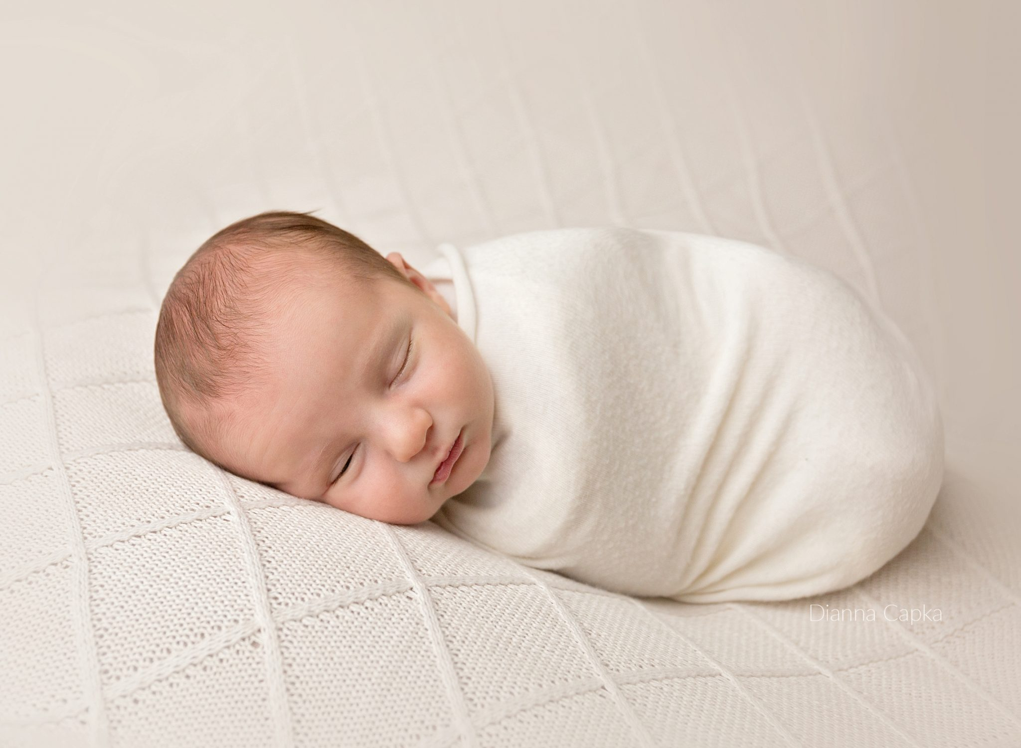 Newborn Boy on Joann fabric backdrop