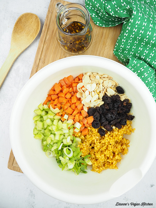 chopped vegetables, cooked rice, cherries, and almonds in bowl